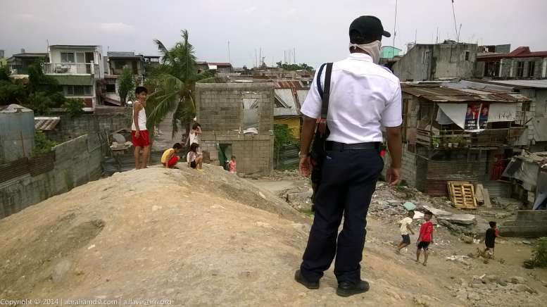 Security Guard stands guard against the children.