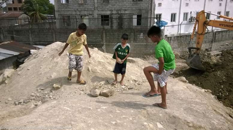 Kids playing again, destructing boulders as their past time.