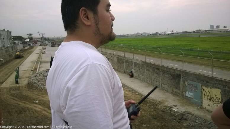 Newcomer planespotter holding his radio, tuned in to the air frequencies used by civil aviation.